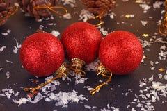Red satin Christmas ball on black Stock Images