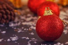 Red satin Christmas ball on black Royalty Free Stock Photo