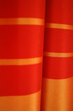 Red satin curtain. The image depicts some curtains made of red satin fabric Stock Images