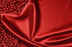 Red satin drapery and beads Stock Images