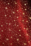 Red satin drapery with glittering golden stars. Christmas background Royalty Free Stock Images