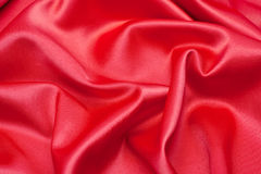 Red satin fabric. As a background Stock Photo