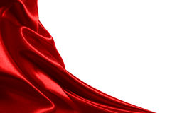 Red satin fabric. With beautiful patterns of folds Royalty Free Stock Images