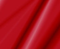 Red Satin Fabric. Folds of red satin fabric with subtle sheen Royalty Free Stock Photo