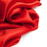 Red satin fabric against white background Royalty Free Stock Photography