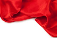Red satin fabric against white background. Studio shot Royalty Free Stock Image