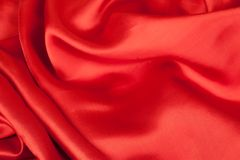 Red satin fabric against white background. Studio shot Stock Image