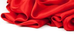 Red satin fabric against white background. Studio shot Royalty Free Stock Photos