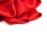 Red satin fabric against white background. Studio shot Royalty Free Stock Photography