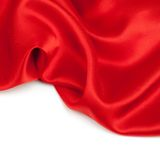 Red satin fabric against white background Stock Photos