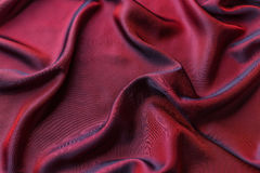 Red satin fabric. As background Stock Photography