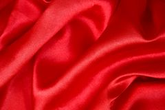 Red satin fabric for background texture. Shiny red satin fabric for background texture Stock Image