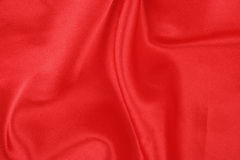 Red satin folded. A rich red satin folded fabric background Stock Photography