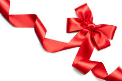 Red satin gift bow. Red ribbon isolated on white Stock Photo