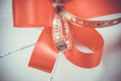 Red satin gift bow. Ribbon. Macro close up Stock Image