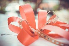 Red satin gift bow. Ribbon. Macro close up Stock Images