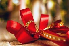 Red satin gift bow. Ribbon. Macro close up Stock Image