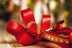 Red satin gift bow. Ribbon. Macro close up Stock Images