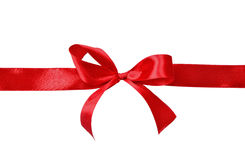 Red satin gift bow. On a white background Royalty Free Stock Photography