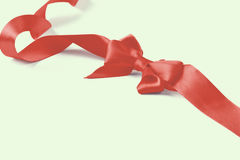 Red satin gift bow  on white background Royalty Free Stock Image