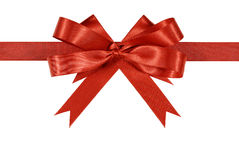 Red satin gift ribbon bow or rosette straight horizontal isolated on white background Stock Photo