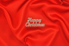 Red satin with Happy Christmas Royalty Free Stock Photos