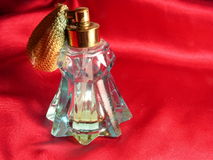 Red Satin and Perfume Bottle Royalty Free Stock Image