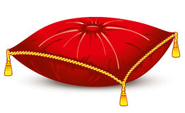 Red satin pillow with gold tassels.  Royalty Free Stock Images