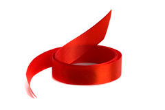 Red satin ribbon. Isolated on white background Royalty Free Stock Images
