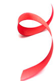 Red satin ribbon. Closeup on white background Stock Images