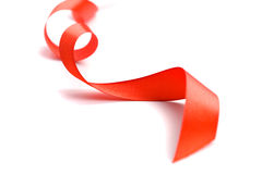 Red satin ribbon. Closeup on white background Royalty Free Stock Photography