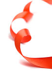 Red satin ribbon. Closeup on white background Royalty Free Stock Image
