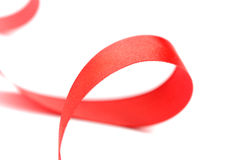 Red satin ribbon. Closeup on white background Stock Photography