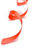Red satin ribbon. Closeup on white background Royalty Free Stock Photos