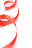 Red satin ribbon. Closeup on white background Stock Photo