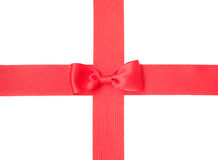 Red satin ribbon with bow. Isolated over white background Stock Photo