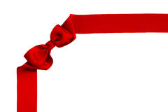 Red satin ribbon bow. Isolated on white background Royalty Free Stock Photography
