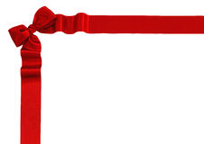 Red satin ribbon with bow. Isolated on white background Royalty Free Stock Photography
