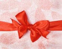 Red satin ribbon bow. Pink gift box royalty free stock photo