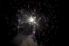 Fireworks burst. With many colors, sparkles, stars and twinkles, horizontal with copy space royalty free stock images