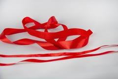 Red satin ribbon  on white backgroun.  stock photos