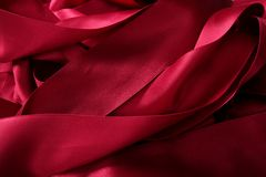 Red satin ribbons in a messy mess texture Stock Images