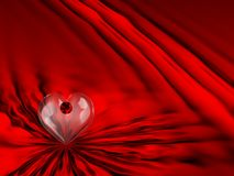 Red Satin Ruby Heart. Beautiful Red Satin/Silk Background With Glass Heart & Ruby Stock Image