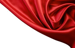 Red satin or silk background. Isolated Royalty Free Stock Image