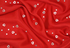 Red Satin with Silver Hearts Royalty Free Stock Photos