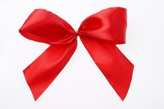 Red satin textile ribbon tied in bow Isolated on white Royalty Free Stock Photography