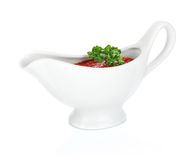Red sauce with greenery in sauceboat Stock Images