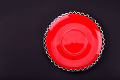 Red saucer. On a black background Royalty Free Stock Photos