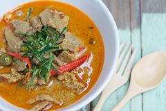 Red savory curry paste with pork and coconut milk Royalty Free Stock Photos