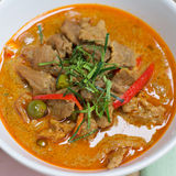Red savory curry paste with pork and coconut milk Stock Photo